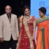 Bollywood actress Juhi Chawla walks the ramp to showcase a creation by
