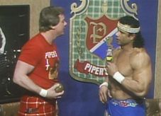 Piper and Snuka square off on �Piper�s Pit� (Image courtesy of