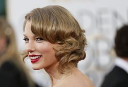 Taylor Swift arrives at the 71st annual Golden Globe Awards in Beverly