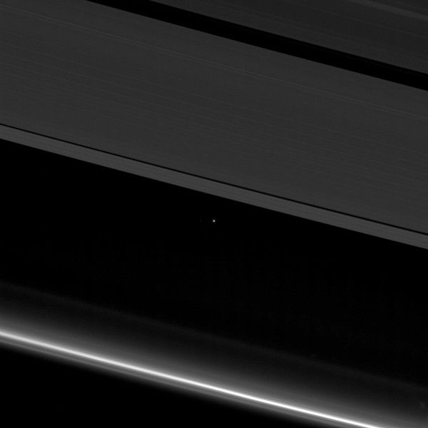 The Earth is just a tiny dot of light in these spectacular photos captured by Nasa probe