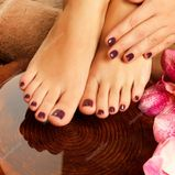photo of a female feet at spa salon on pedicure procedure  Female