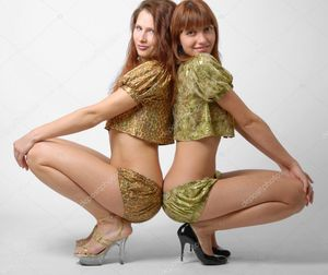 Two girls squatting down, side view | Stock Photo © Олег