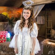 Sadie Robertson as an angel in the Nativity Scene