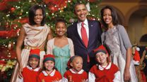 Obamas sing Christmas carols at charity concert in Washington  video