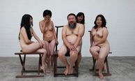 The Chinese artist Ai Weiwei poses with nude women in Beijing