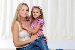 Young mother and her young daughter � Stock Photo � Sergey Nivens
