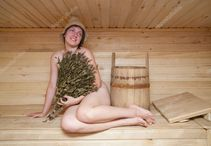Young brunette woman sitting in sauna � Stock Photo � Iakov