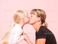Mother and daughter kissing � Stock Image � Lisa Quarfoth #3642499