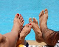 Male and female feet � Stock Photo � Julija Sapic #3622725