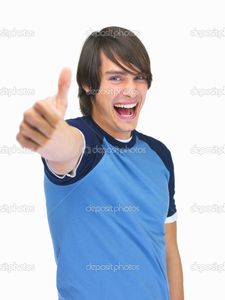 Excited teenaged guy showing a thumbs up on white | Stock Photo