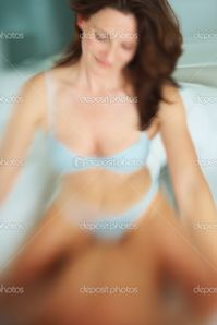Woman having sex with husband on bed | Stock Photo © Yuri Arcurs