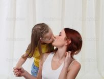 Daughter and mother kissing — Stock Photo © Alexey Tyumentsev