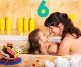 Mother and daughter washing in bath  � Stock Image � Gennadiy