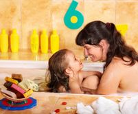 Mother and daughter washing in bath  — Stock Image © Gennadiy