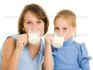 Mom and daughter drink milk  | Foto stock © Sergey Khamidulin