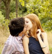 Young couple in love kissing outdoors. — Stock Image