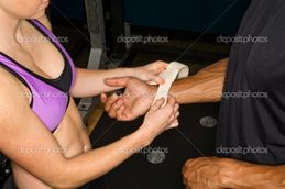 Woman placing wrist strap on arm  — Stock Photo © iofoto #9254667