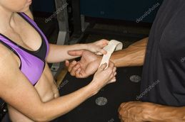 Woman placing wrist strap on arm  � Stock Photo � iofoto #9254667