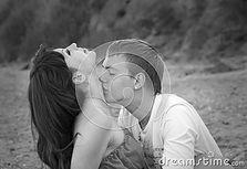 Couple Enjoying Themselves On The Beach Royalty Free Stock Photos