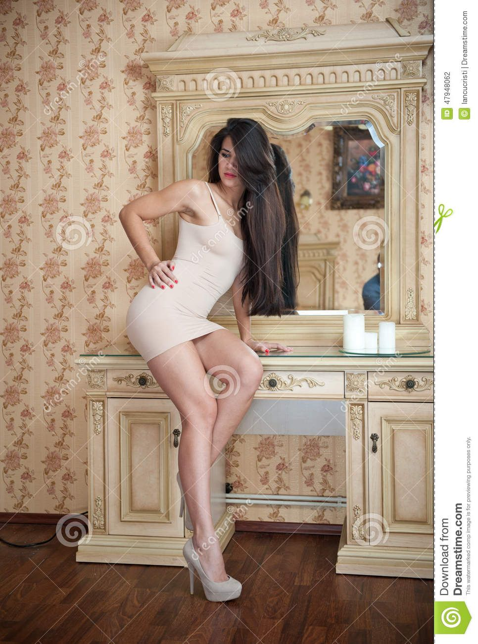 Long Haired Brunette Doing Taking Pictures In Front Of A Mirror