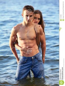 Outdoor portrait of beautiful romantic couple of topless girl and