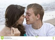 Couple Enjoying Themselves On The Beach Stock Photos  Image: 13816063