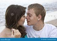 Couple Enjoying Themselves On The Beach Stock Photos  Image: 13816063