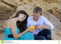 Couple Enjoying Themselves On The Beach Stock Photo  Image: 13816070