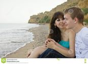 Couple Enjoying Themselves On The Beach Stock Images  Image: 13960654