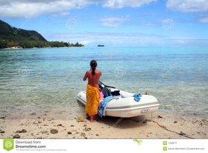 Topless Woman On The Beach Aside An Inflatable Boat Stock Image