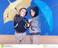 Twins Brother Have Fun Under An Umbrellas Stock Images  Image