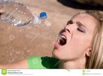 Woman Squirting Water From Bottle Stock Photography  Image: 11108042
