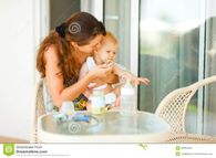 Young Mama Feeding Look Aside Baby At Terrace Stock Photos  Image