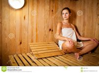 Sauna spa therapy beautiful young people group in warm wood room white