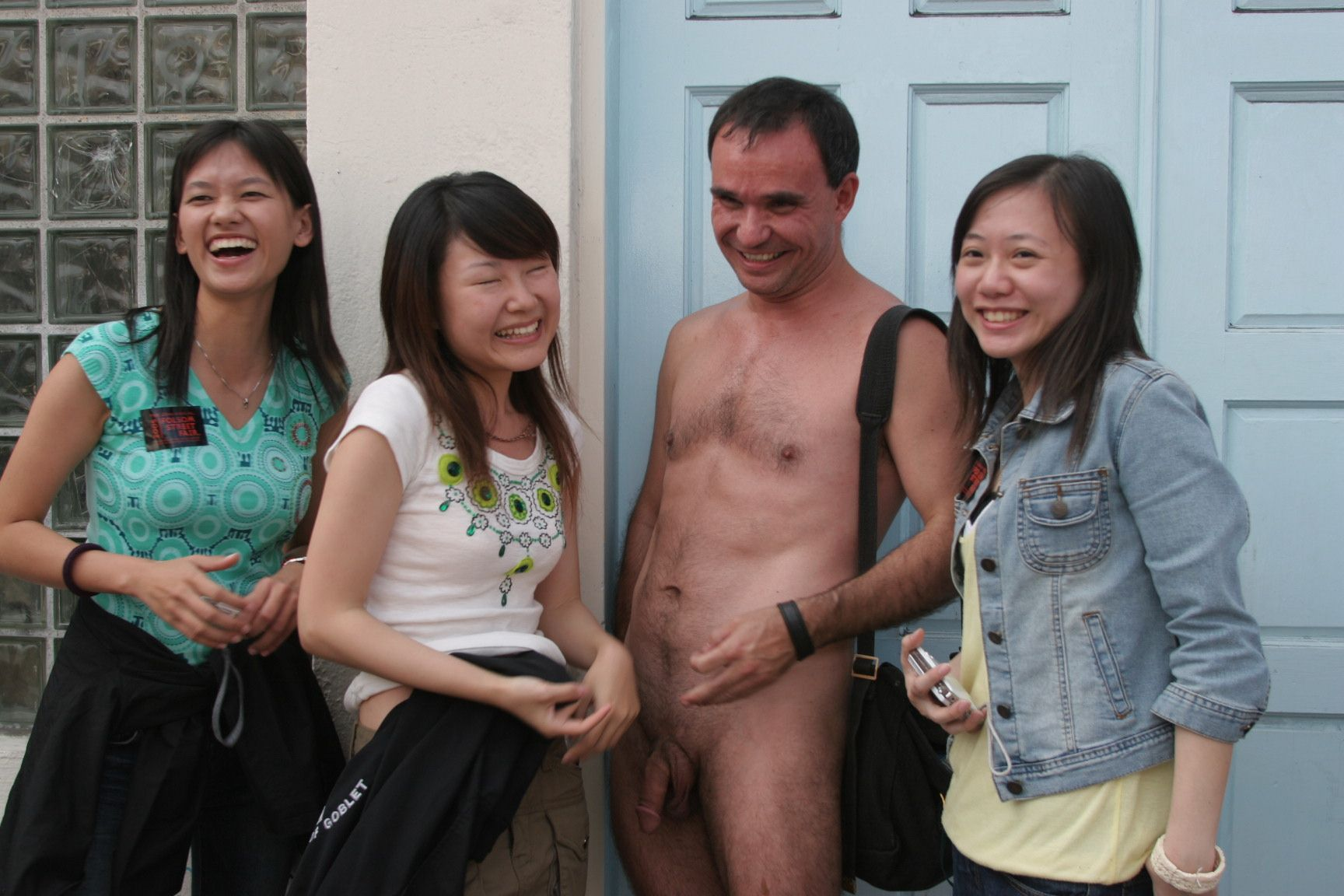 3 Clothed Gals And The Nude Man