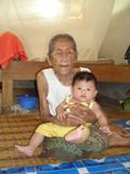Description Old woman with young baby boy JPG