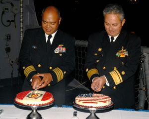 Salazar cut cakes during a reception aboard the guided missile frigate