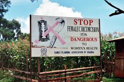 Description Campaign road sign against female genital mutilation.jpg