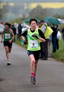 Nicki Nealon apporaching the finish in the wet weather with Silson