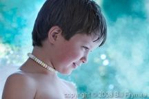 children » Model released close up of young boy with candy necklace