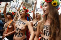 Members from the topless women's rights group Femen, take part in a
