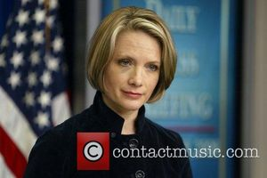 White House Press Secretary Dana Perino stuns reporters as she steps