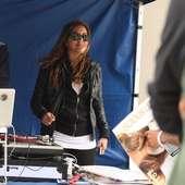 Liz Hernandez Aka Luscious Liz Broadcasting Her Radio Show In Front