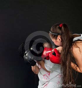 Two white girls are boxing with mufflers on black background