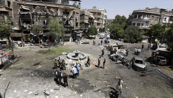 Car bombs kill 8 in Damascus; Syria says it foiled attack