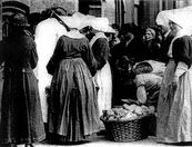 The Daughters of Charity of St Vincent de Paul dispensing bread in