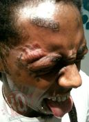"Lil Wayne Gets ""Baked"" Tattoo On Forehead"