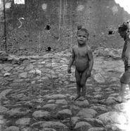 Melissa (Crotone)  Bambino nudo in una strada, Treccani, Ernesto