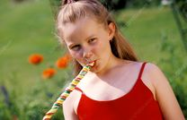 Young girl eating lolly  Stock Image P920/0483  enlarged  Science