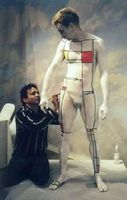 Photo of male model being bodypainted to appear as a painting in the